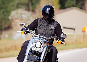 front of biker riding on highway